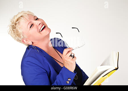 middelaged business woman in jacket with glasses r - Stock Photo