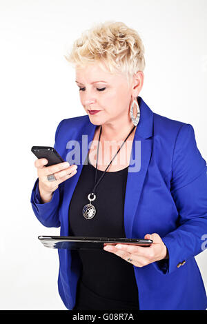 middelaged business woman in jacket talking on the - Stock Photo