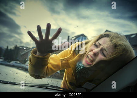 young woman strikes in an accident on the windshi - Stock Photo