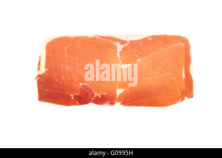 closeup on a piece of spanish serrano ham - Stock Photo