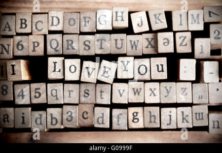 Wood cube make message i love you - Stock Photo