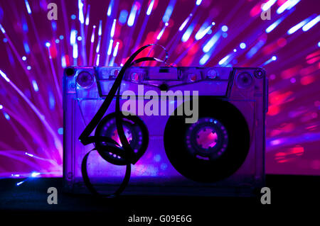 Transparent Cassette tape and disco light background - Stock Photo