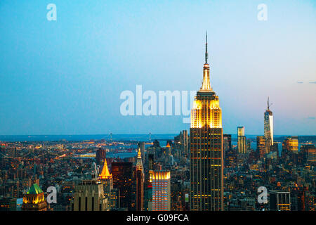 New York cityscape in the night with Empire State - Stock Photo