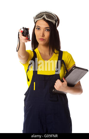The worker with a handheld transceiver specifies the direction - Stock Photo