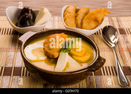 ... Elegant table setting with full serving of traditional fanesca soup and accessories - Stock Photo & Elegant table setting with full serving of traditional fanesca soup ...