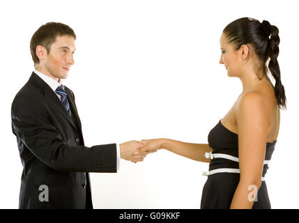 Successful young business executives shaking hands - Stock Photo