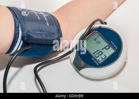 Sphygmomanometer measuring blood pressure on an ar - Stock Photo