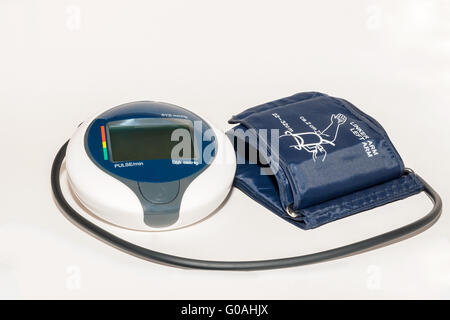 Household blood pressure monitor isolated against - Stock Photo