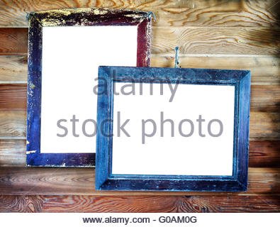 Two old vintage wooden frames hanging on the wall Stock Photo ...