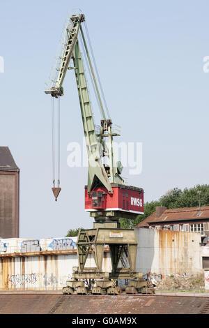 Dockside crane, Inner harbor Duisburg, Germany - Stock Photo