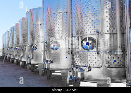 Modern aluminum barrels where grape juice is aged into wine - Stock Photo