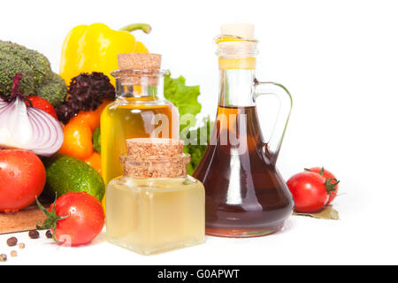 vegetables and few vessels with oil - Stock Photo