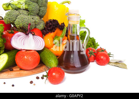 vegetables and oil in a vessel - Stock Photo