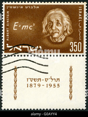 ISRAEL - 1956: shows Albert Einstein (1879-1955) and Equation of his Relativity Theory - Stock Photo