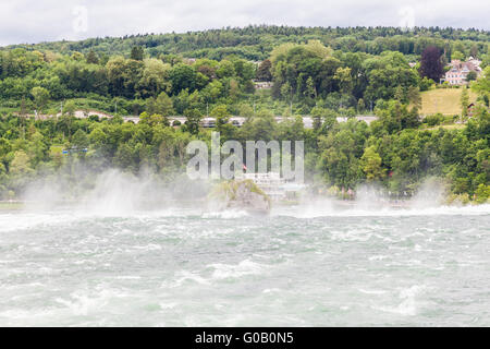 The large waterfall on Rhine river, Schaffhausen, Switzerland - Stock Photo