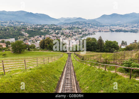 View of the Lugano city and lake from the railway track to Monte San Salvatore, Ticino, Switzerland - Stock Photo