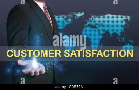 Business concept image of a businessman showing Customer Satisfaction words on his hand over blue background with - Stock Photo