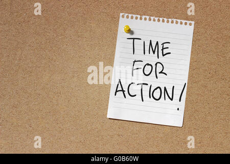 Handwriting of Time For Action written on white note paper over textured wall - Stock Photo