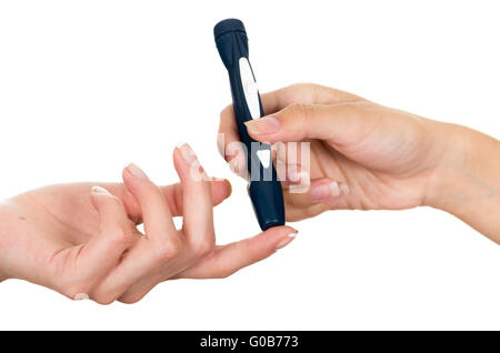 Doctors hand holding glucose measure scanning pen on patients finger with white background - Stock Photo