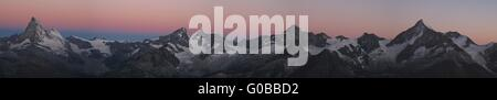 Beautiful mountain range in Zermatt at sunrise - Stock Photo
