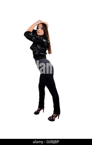 Young teen girl in black jacket and jeans - Stock Photo
