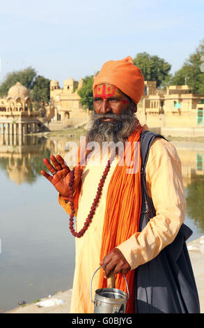 Holy Sadhu men with traditional painted face in India - Stock Photo
