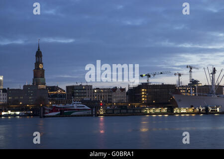 The harbor of Hamburg with St. Michaelis, Germany - Stock Photo