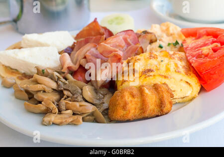 Breakfast : scrambled eggs, ham , mushrooms and ve - Stock Photo
