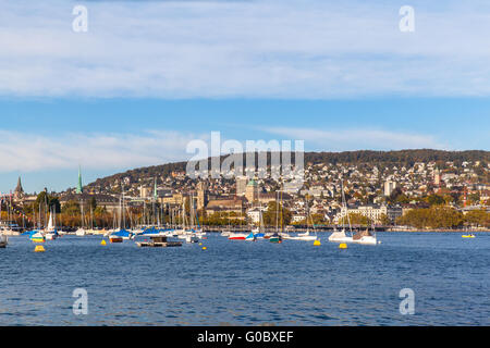 Beautiful view of the Zurich old town before sunset from the lake side at Mythenquai, ,Zurich, Switzerland - Stock Photo