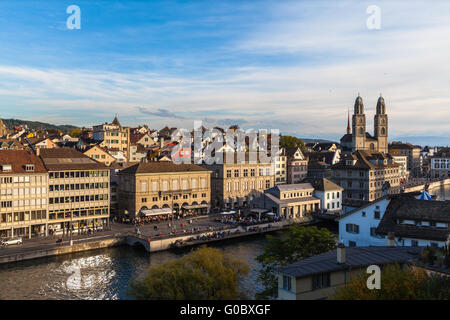 Aerial view of Zurich old town with Grossmunster Church and Limmat river at dusk, Zurich, Switzerland. - Stock Photo