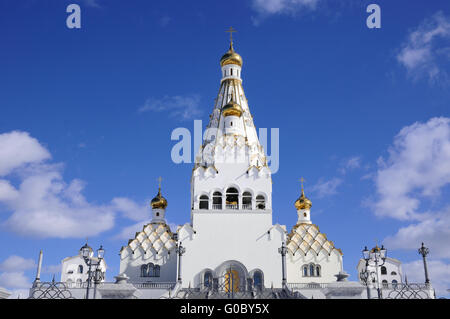 bright Orthodox Church under clear blue sky; All Saints orthodox Church in Minsk - Stock Photo