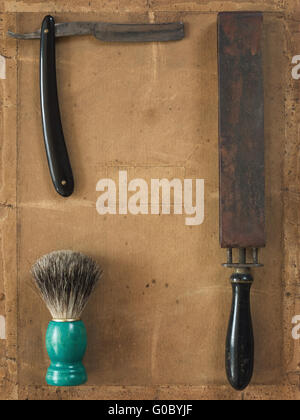 Flat Lay of Shaving Equipment on vintage Backdrop - Stock Photo