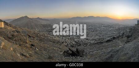 Scenic panorama of sunset in Kabul - Stock Photo
