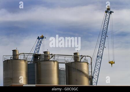 Large tanks on the port - Stock Photo