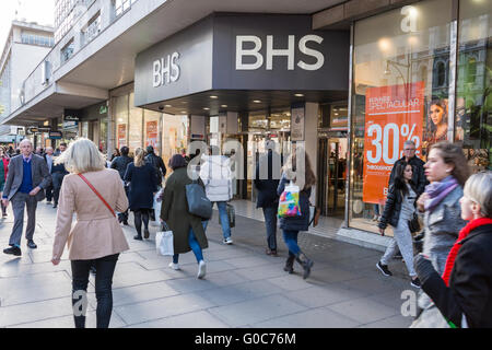 Shoppers pass in front of the former flagship BHS store on London's Oxford Street. - Stock Photo