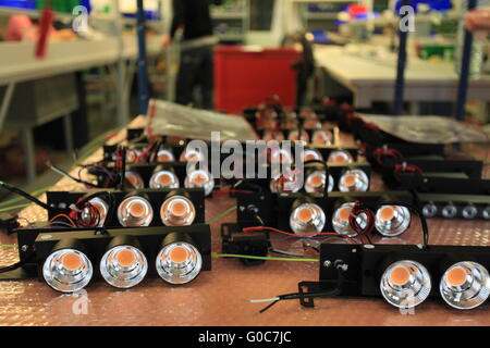assembly of LED lights in manufacturing - Stock Photo