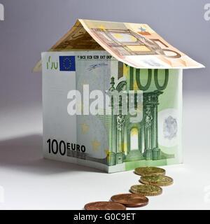 House made of euro banknotes, symbolic image - Stock Photo