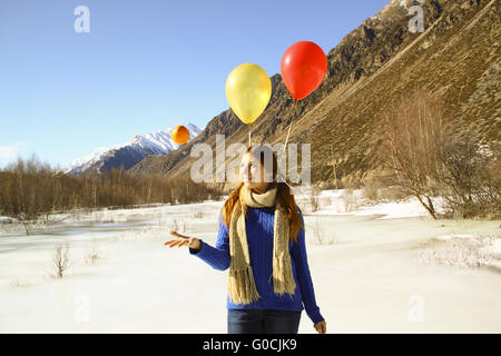 Funny girl with oranges and balloons on the hair o - Stock Photo