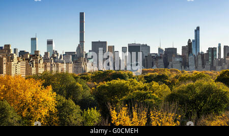 Fall in Central Park with Midtown and Central Park South skyscrapers with Upper East Side high-rise buildings. New - Stock Photo