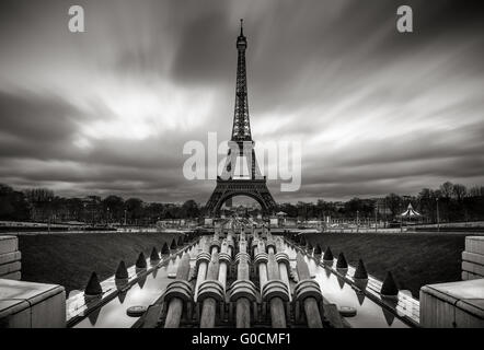 Eiffel Tower and Trocadero at sunrise with fast moving clouds, Paris, France. Black & White. - Stock Photo