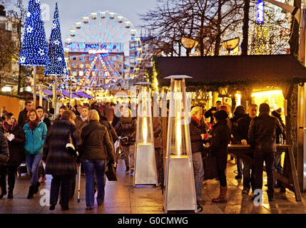Christmas market with ferris wheel in the evening - Stock Photo