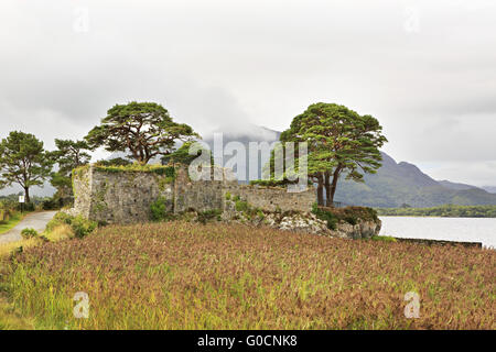 Ruins of an ancient fortress on Lough Leane Lower Lake. - Stock Photo