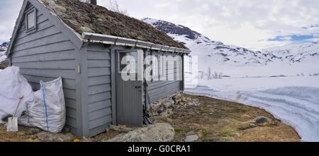 Mountain cabin near Trolltunga in Norway - Stock Photo
