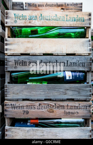 Wooden wine boxes, filled with empty wine bottles, branded with wine from Germany, - Stock Photo