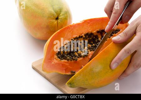 Papaya Cut In Half Along Its Longitudinal Axis - Stock Photo