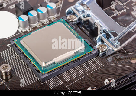 CPU socket on motherboard with installed processor - Stock Photo