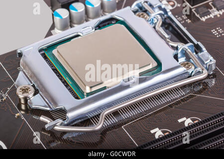 CPU socket on motherboard with installed a process - Stock Photo