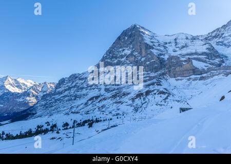 Stunning view of Eiger North face of swiss alps from Kleine Scheidegg in Winter, on Bernese Oberland near Jungfrau, - Stock Photo