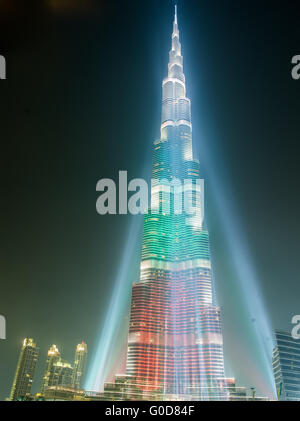 DEC 03 -DUBAI, UAE:  Burj Khalifa Tower floodlit in the white, green and red colours of the flag of the United Arab - Stock Photo