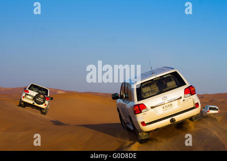 NOV 29 -DUBAI, UAE:  4x4 drives in the desert during a safari in the dunes on the 29th of november 2013 in Dubai, - Stock Photo
